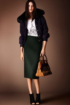 Burberry Prorsum   Pre-Fall 2014 Collection   Wool navy jacket with fur neckline paired with a simple green midi skirt and printed London iconic skyline symbols t-shirt