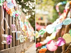 Garden party decor / Hanging jam jar tea light holders accent a fence, and circular tissue paper streamers are bright and cheerful / #DIY decorations