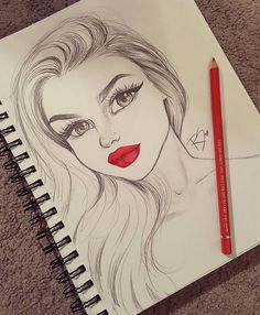 drawing of a girls face in pencil with red coloured pencil lips