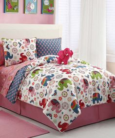 Pink Elephant Comforter for when she outgrows her crib. This will let us keep her elephant theme a little bit longer.