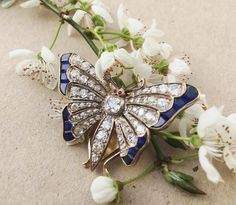 Spring has arrived! This butterfly is an exceptional piece of period jewellery. #diamonds #sapphire #rubies #brooch #wow #love #photooftheday #instalike #blossom #butterfly #spring