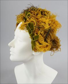 1950's ostrich feather hat (front view)   Golden tones, and brown ostrich feathers, olive green velvet bows. This is a very popular style from this period, and also earlier
