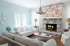 just PAINT IT!  paint the rock around my fireplace to get rid of the 70s orange/brown and create the palate I want