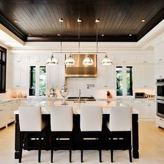Beautiful kitchen! That dark ceiling is a bold risk.....and it paid off - Huge impact!