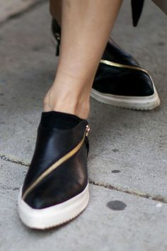Pointed toe and asymmetrical zipper?! love! I normally don't wear sneakers but for 2015.. I'm finding a pair for sure..