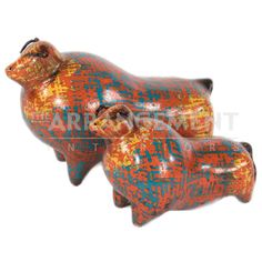 Orange Bull Sculpture Pottery  This minimalist Bull Sculpture Pottery is a great modern piece to add to any Southwestern or Spanish style. An abstract design in a orange, blue, and yellow design patina, this sculpture comes in two sizes and a variety of colors. It portrays bulls in their natural state and gives a nod to mid-century decor.