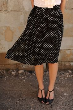 Black skirt with white poco dots , white blouse, black pumps, not black toe nail although they look great ,this was my uniform for years