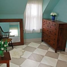 Painting a checkerboard pattern on old floors is a budget-saving alternative to refinishing them and adds instant personality. Cost: About $75