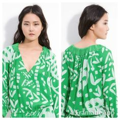 "Diane Von Furstenberg Mikino Top size 12 $295 Diane Von Furstenberg Printed Mikino Blouse size M. $295 retail sold out! Rare Colorway! No stains or holes- small snag on bottom front near hem- see pic- not really visible in print. Vivid green and white and striking!  DVF Mikino Top   This crepe DVF blouse features accordion pleats and a drawstring at the split V neck. Gathered elastic at hem and at cuffs. Long sleeves.  * 23"" long, measured from shoulder. * Fabrication: Crepe. * 100%…"