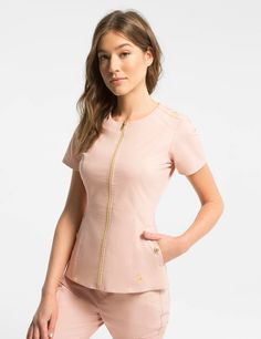 Biker Top in Blushing Pink - Medical Scrubs Biker Top in Blushing Pink is a contemporary addition to women& medical scrub outfits. Shop Jaanuu for scrubs, lab coats and other medical appare. Spa Uniform, Scrubs Uniform, Jaanuu Scrubs, Stylish Scrubs, Scrubs Outfit, Lab Coats, Medical Uniforms, Womens Scrubs, Uniform Design
