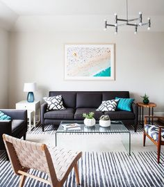 Patterned rug in modern living space with beach art