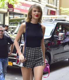Taylor swift was wearing a similarly flirty outfit and a big smile.