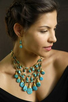 Isn't Turquoise usually paired with silver? Love the bolder look of this Tibetan Turquoise with gold wrapping