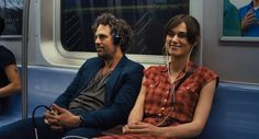 "Mark Ruffalo and Keira Knightley listen to a song together on the subway in ""Begin Again"": http://www.dvdizzy.com/beginagain.html"