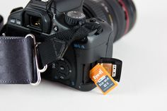 Eye-Fi - the memory card that has adds wifi to any camera that uses SD memory. Upload photos right from the camera w/o ever taking out the card.