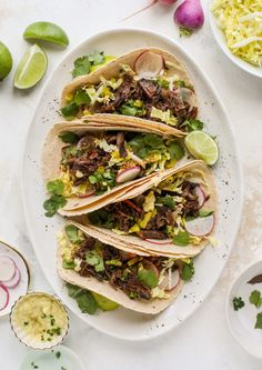 These are the best smoky short rib tacos made in the slow cooker! Served with a banana pepper mustard and napa cabbage slaw, it's a flavor explosion. Short Rib Tacos – Smoky Short Rib Tacos with Pepper Mustard Slaw (How Sw Rib Recipes, Lunch Recipes, Easy Dinner Recipes, Mexican Food Recipes, Entree Recipes, Dinner Ideas, Recipies, Pickled Banana Peppers, Stuffed Banana Peppers