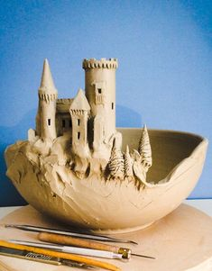 """Work in progress. This is a large bowl (11"""" diameter) that is destined to have a wrap around scene of Dracula's Transylvania. The main castle was attached to the bowl today with much detail still to do. The scene will move around the bowl with a road..."""