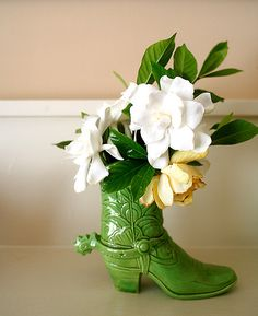 Boot as a vase(put a glass inside) or could be a plant if filled with dirt. This boot is probably ceramic...but it could easily be a DIY, using gloss paint.