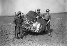 Soldiers carrying off the tail of a Messerschmitt 110, which was shot down by fighter planes in Essex, England, on September 3, 1940. (AP Photo)