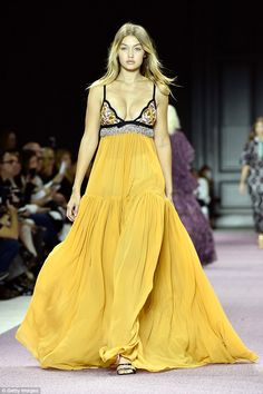 Supermodel Gigi Hadid walks the runway in a flowing yellow Giambattista Valli gown