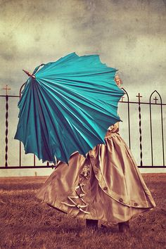 A #steel #gray gown and a #turquoise umbrella. She must be a Zeta Tau Alpha.