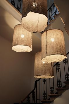 .Grey linen or cotton hung from a ring chandelier - wabi sabi style