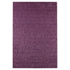 Hand-loomed New Zealand wool rug with an interlocking medallion motif.  Product: RugConstruction Material: WoolColor: PlumFeatures: Handmade Note: Please be aware that actual colors may vary from those shown on your screen. Accent rugs may also not show the entire pattern that the corresponding area rugs have.