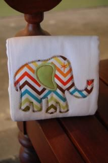 """APPLIQUED BLUE ZIG ZAG ELEPHANT BURP PAD  3 Marthas burp pads aren't just beautiful - they are one of the most useful products we offer. The super absorbent burp pads measure a generous 14.5"""" by 21"""" and are made of 100% cotton. Everyone knows that moms just can't have enough of these beautiful necessities!"""