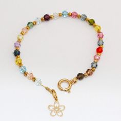handmade colorful bracelet, crystal beads, and tiny flower. by MaYaJEWELRYDESIGN on Etsy https://www.etsy.com/listing/221959696/handmade-colorful-bracelet-crystal-beads