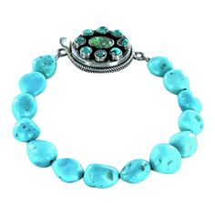 KINGMAN TURQUOISE BRACELET CARICO LAKE CLASP STERLING from New World Gems