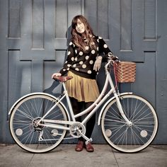Cute polka dot sweater and a beautiful white #bike