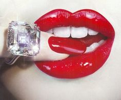 Fabulous red lips and diamond ring.