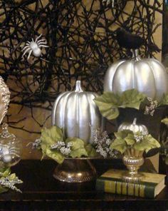 Artificial pumpkins spray painted silver! I'd add a few orange and black spray painted gourds in there, as well :)