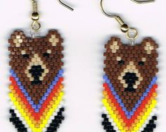 Here is a beautiful pair of Orange Tabby Cat head Earrings. They measure 1 1/4 by 1 1/2. They were designed by Mary Hipple and beaded by me in a smoke free home  Thank you for looking I do combine shipping