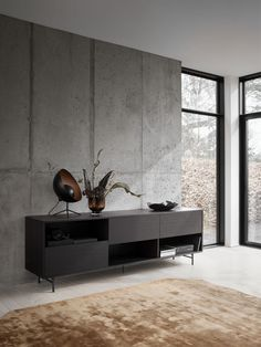With clean, elegant lines, every inch of the Manhattan sideboard is there for a reason. This design is a celebration of simplicity and functionality whilst still packing a stylish punch. Streamline your workspace with the new Manhattan sideboard. Concrete Bedroom, Concrete Interiors, Concrete Walls, Concrete Ceiling, Beton Design, Concrete Design, Manhattan, Wall Design, House Design