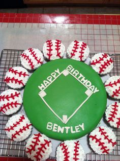 For Seth.Baseball cake and cupcakes, I could easily make this for the boys' party this next spring!