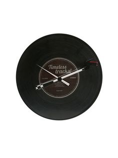 somebody get me this!    Spinning Record Timeless Tracks Wall Clock by Karlsson by Present Time on Gilt Home  Record actually spins as it displays the time  Labelled dial rotates and works like a second hand  Gramaphone-stylus shaped hour hand  Cool retro gift idea for music lovers and musicians  Requires 2 c batteries  Measures 12 inches in diameter
