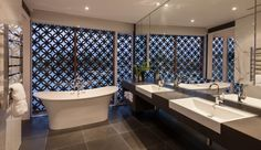 Promenade Residence by BGD Architects   like the idea of the screen-private yet you still have the view from the bathtub!