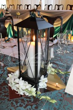 lantern centerpiece | lantern centerpiece  Could be cute on the table where you and James are going to sit