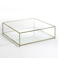 Sybil square coffee table. The elegant, transparent look brings a light and airy feel into the home.Metal frame with an aged brass finish.2 tempered glass tops, 8mm thick.Measurements:L100 x H33 x D100cm.