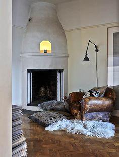 H&M Home's Head of Design Masters the Art of High & Low // fireplace, leather chair, fur rug