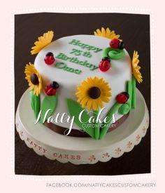 © Natty Cakes Custom Cakery   Sunflower and ladybug cake