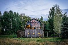Resembling the classic farmstead outbuilding on the outside, The Barn uses a mix of rustic finishes and modern updates for a one-of-a-kind guesthouse. Clad in reclaimed barnwood and cedar shake ...