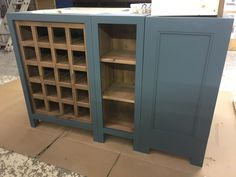 Kitchen island base in F&B Inchyra Blue with rustic plank . Bespoke furniture at affordable prices. Cobwebs Furniture Company.