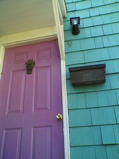 blue teal house with pink door by nic221, via Flickr