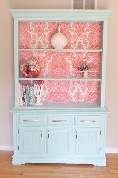 Welcome to the Mouse House....china cabinet blue redo. Love the pattern background made from fabric