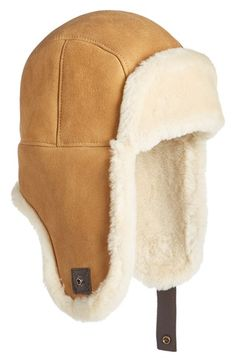 Free shipping and returns on UGG® Genuine Shearling Trapper Hat at Nordstrom.com. Wonderfully soft shearling adds serious warmth to a trapper-style hat with cozy earflaps that can be snapped up out of the way when the wind is calmer.