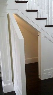 stair storage - door that looks like wall panel. Perfect place to store  Christmas decorations