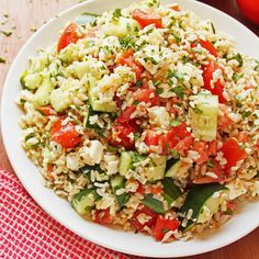 Tomato Basil Cucumber Salad with Feta Cheese and Brown Rice.