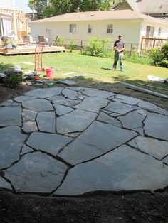 New stone patio! How to build and install a flag stone patio. #howto #patio #diy #stone